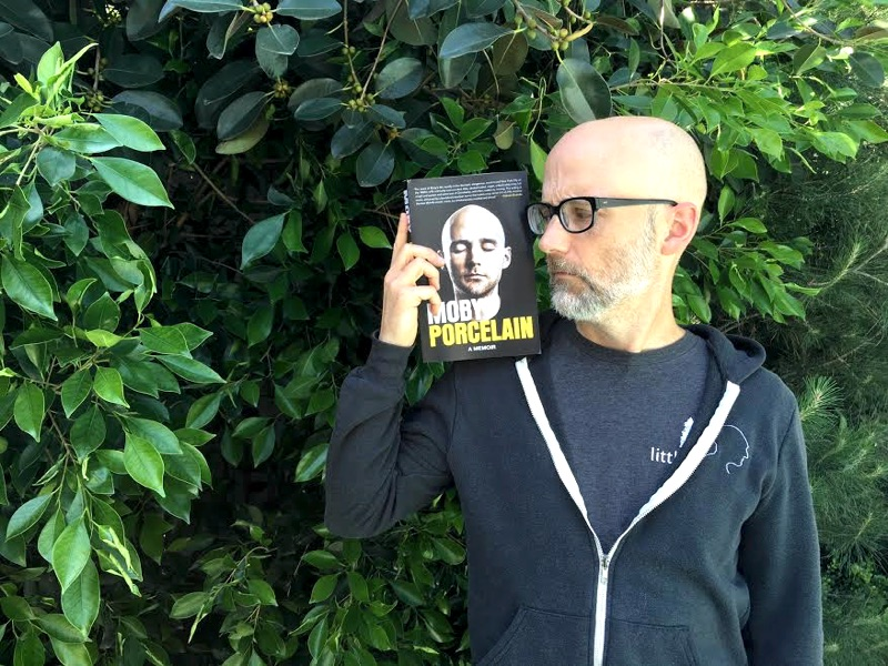 moby-with-book-in-garden